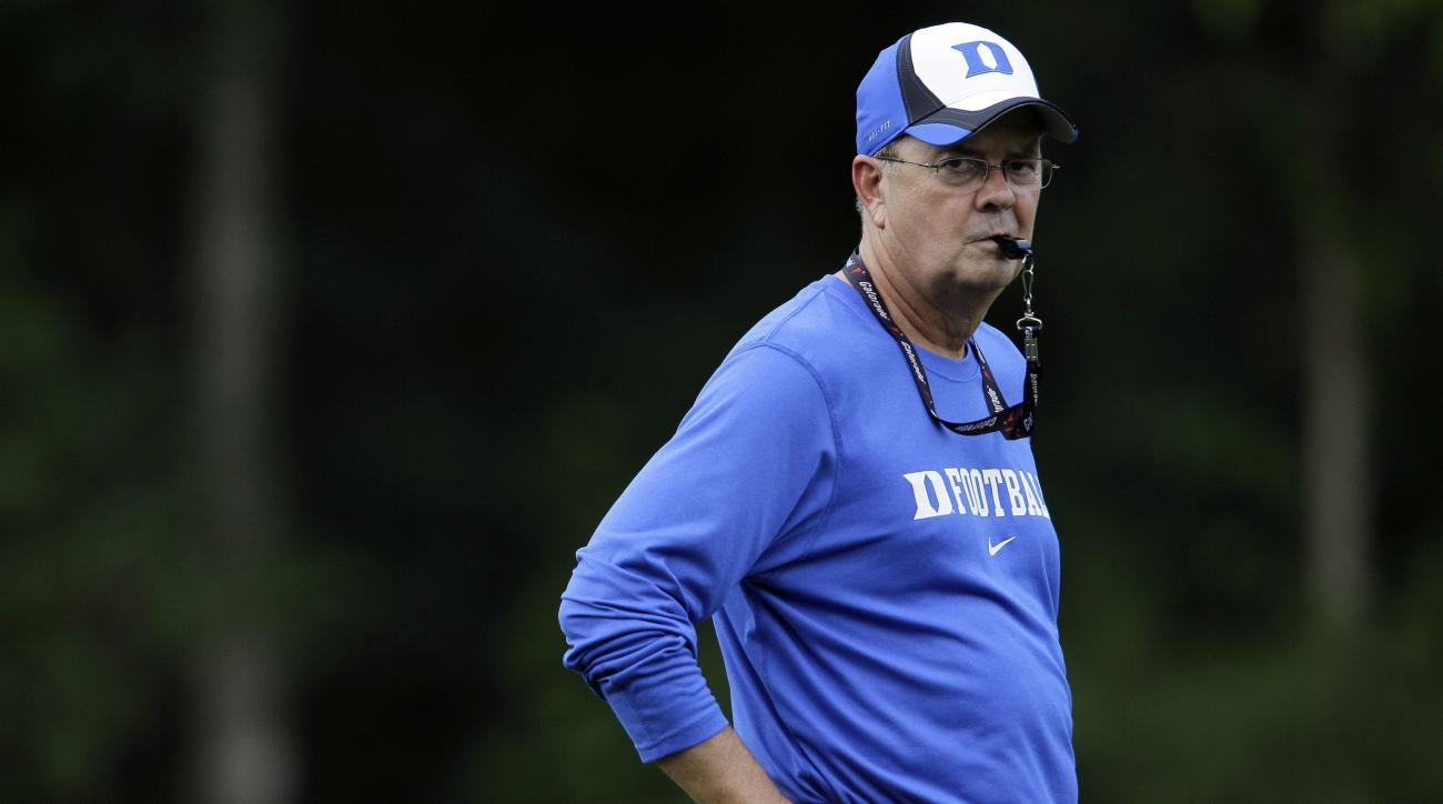 FILE - In this Tuesday, Aug. 10, 2010, file photo, Duke coach David Cutcliffe watches during NCAA football practice in Durham, N.C. If Duke cant keep its grip on the ball, the Blue Devils might lose control of their season, too. A suddenly turnover prone