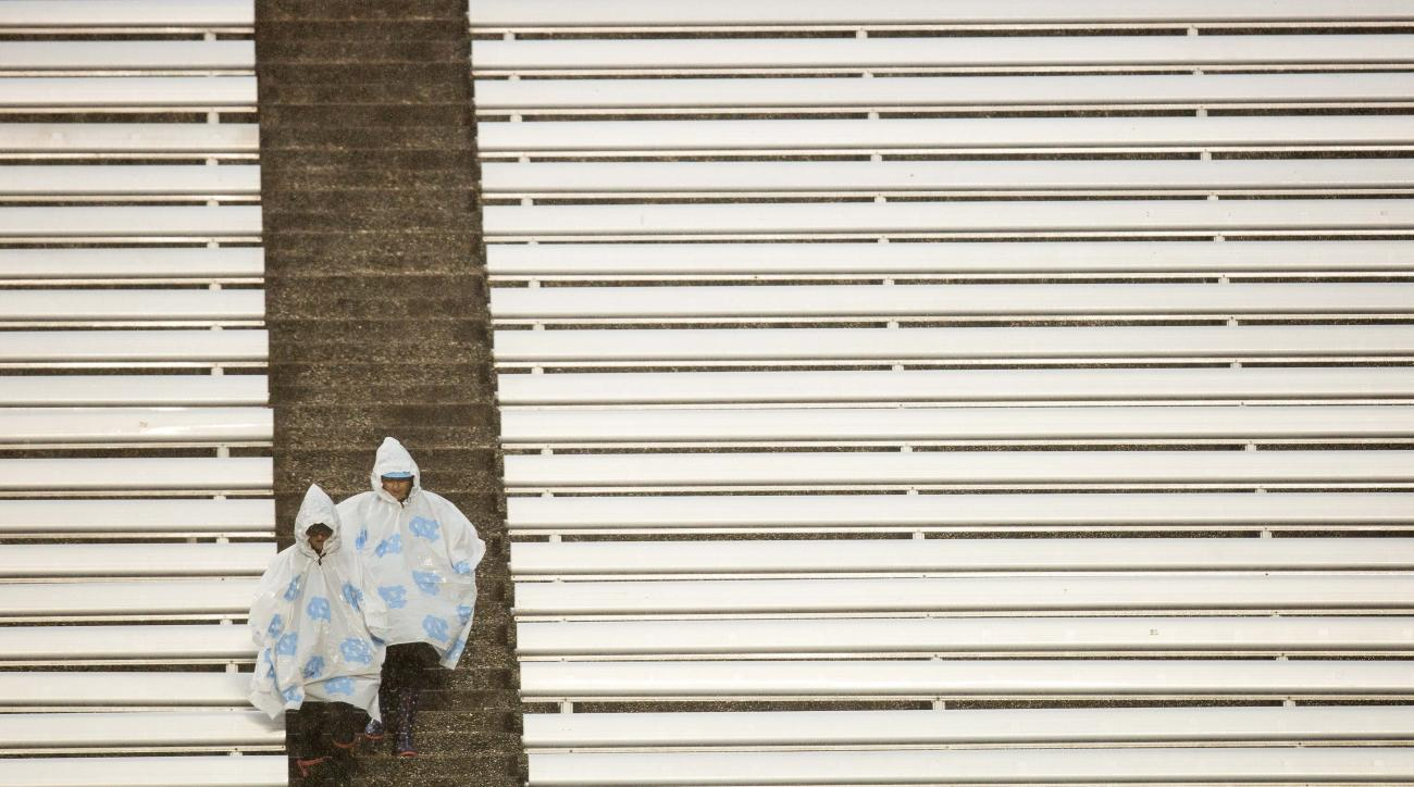 A pair of fans enter Kenan Memorial Stadium prior to the start of an NCAA football game between North Carolina and Virginia Tech Chapel Hill, N.C. Saturday, Oct. 8, 2016. (AP Photo/Ben McKeown)