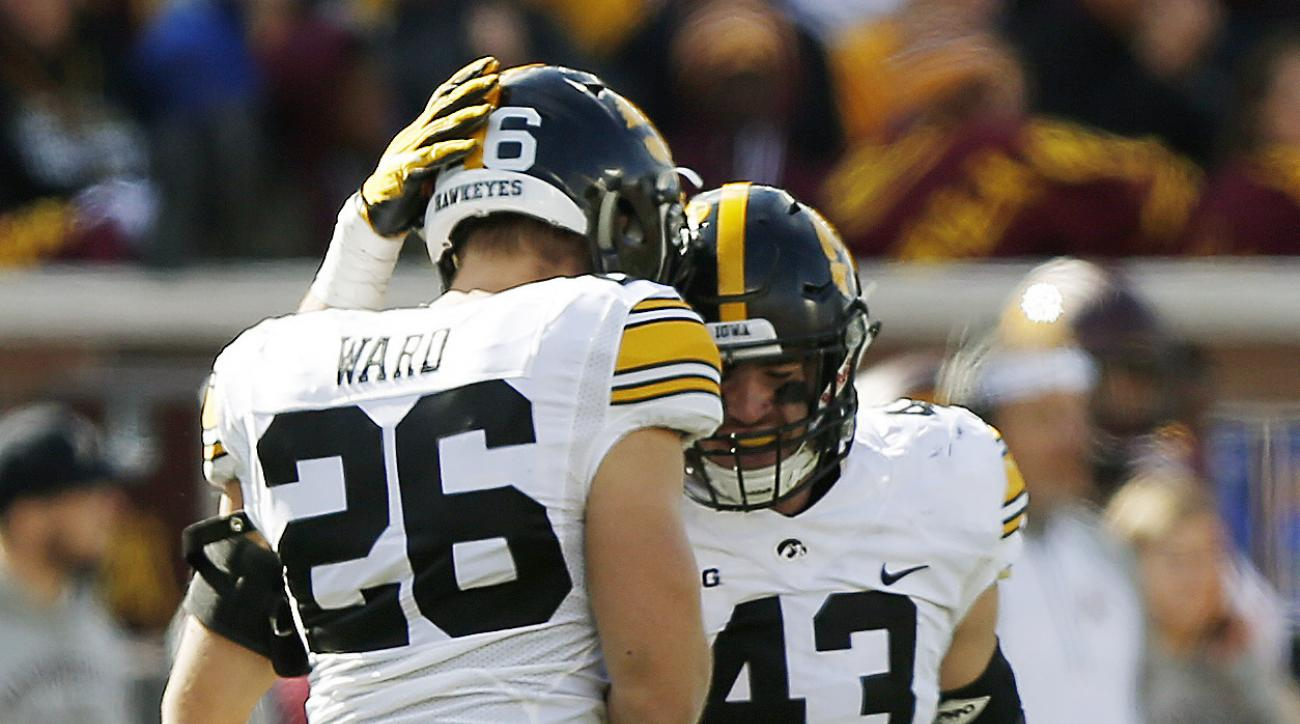 Iowa's Kevin Ward, left, and Josey Jewell share a moment on the field during an NCAA college football game against Minnesota, Saturday, Oct. 8, 2016, in Minneapolis. (AP Photo/Stacy Bengs)