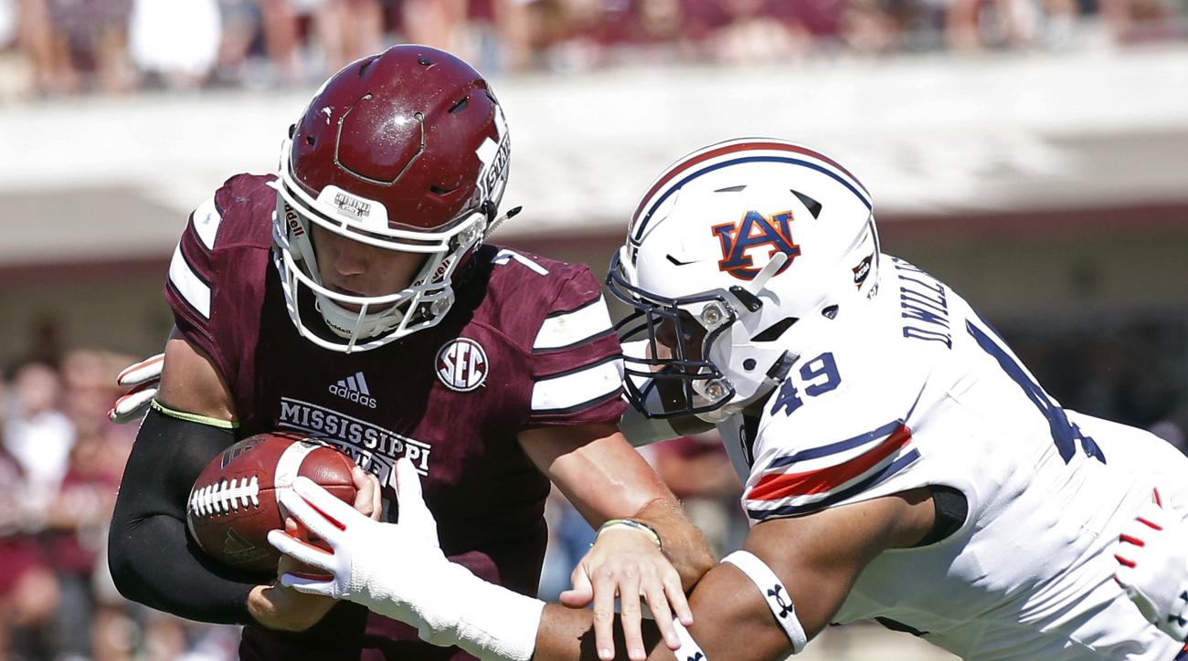 Mississippi State quarterback Nick Fitzgerald (7) is tackled by Auburn linebacker Darrell Williams (49) in the second half of an NCAA college football game, Saturday, Oct. 8, 2016, in Starkville, Miss. Auburn won 38-14. (AP Photo/Rogelio V. Solis)