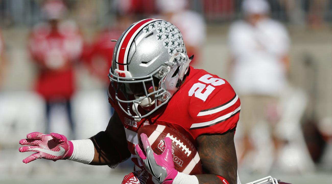 Ohio State running back Mike Weber, top, is tackled by Indiana linebacker Tegray Scales during the first half of an NCAA college football game Saturday, Oct. 8, 2016, in Columbus, Ohio. (AP Photo/Jay LaPrete)