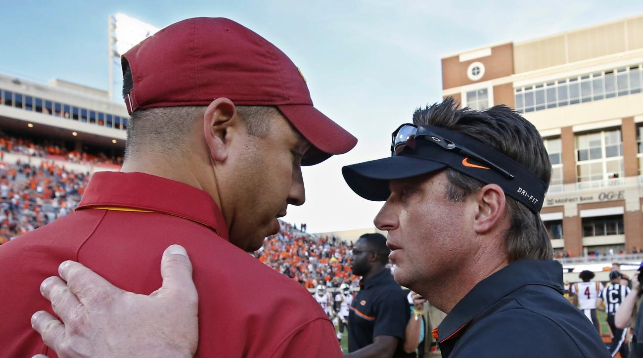 Iowa State head coach Matt Campbell, left, and Oklahoma State head coach Mike Gundy right, talk following an NCAA college football game in Stillwater, Okla., Saturday, Oct. 8, 2016. (AP Photo/Sue Ogrocki)