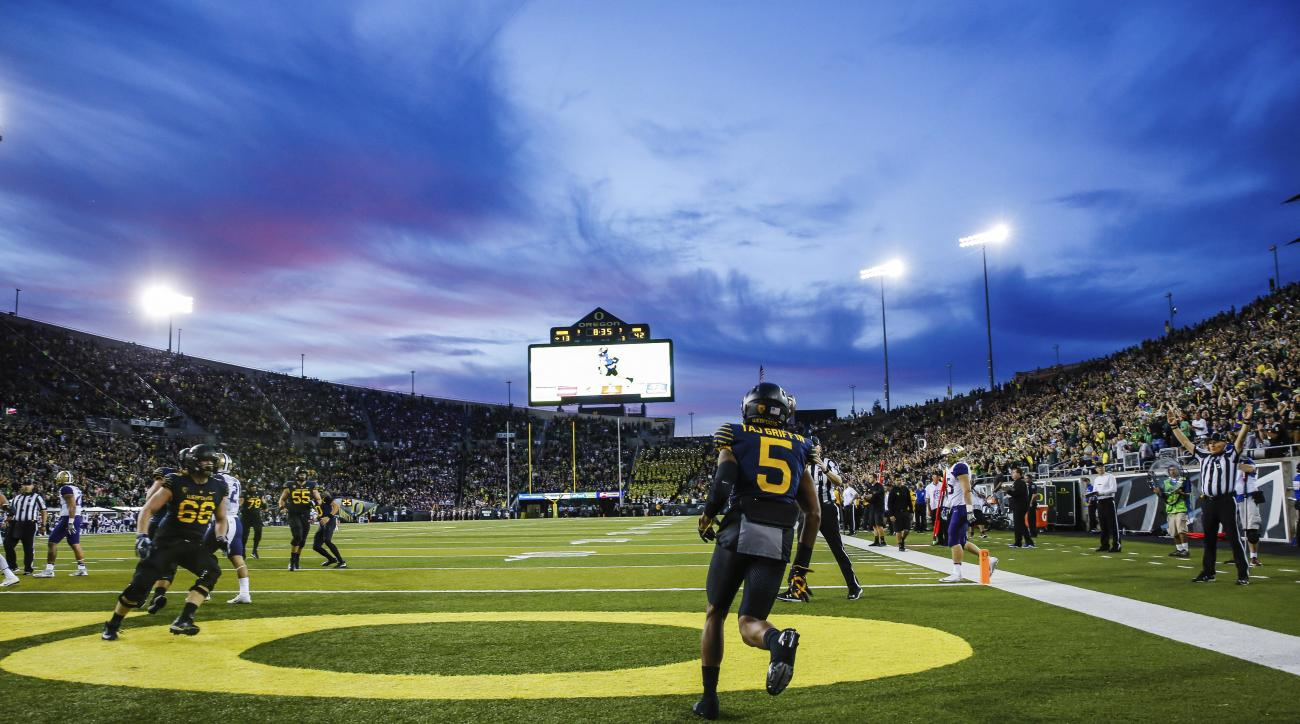 Oregon running back Taj Griffin (5) heads back to the bench after scoring against Washington in an NCAA college football game Saturday, Oct. 8, 2016, in Eugene, Ore. Washington won 70-21. (AP Photo/Thomas Boyd)