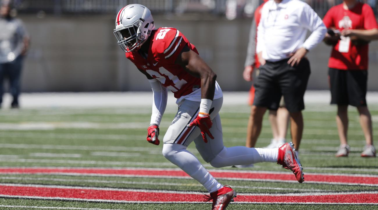 FILE - In this April 16, 2016, file photo, Ohio State wide receiver Parris Campbell plays in Ohio State's NCAA college football spring game, in Columbus, Ohio. Wide receiver Parris Campbell is getting coach Urban Meyers attention as a special teams stando