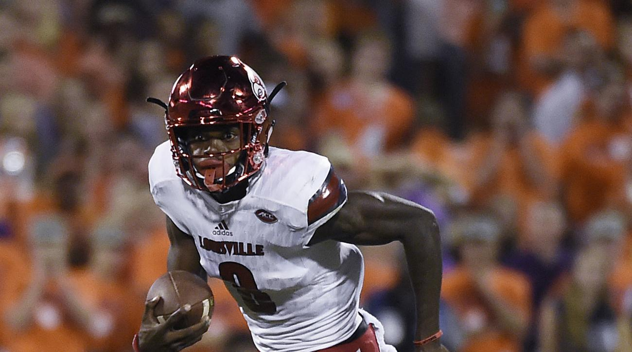 FILE - In this Oct. 1, 2016, file photo, Louisville quarterback Lamar Jackson (8) scrambles as Clemson defensive end Chris Register (45) defends during the first half of an NCAA college football game, in Clemson, S.C. The challenge for Lamar Jackson as he
