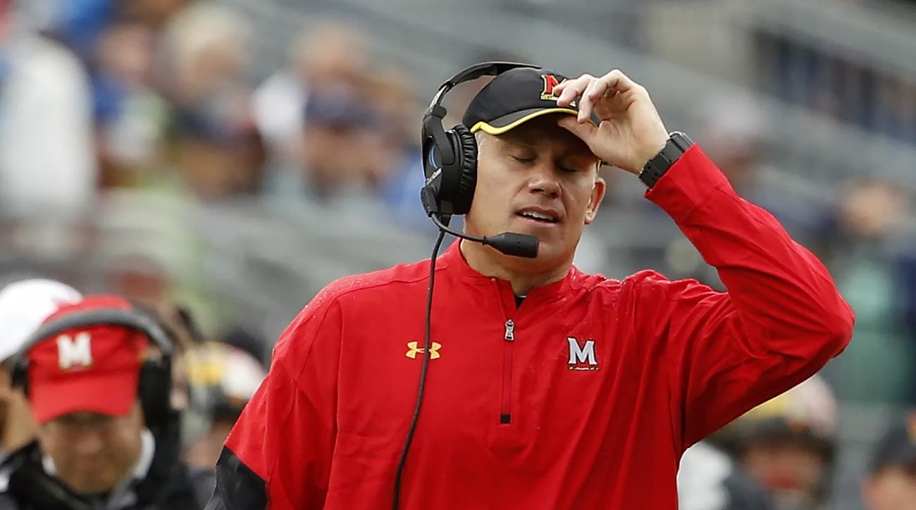 FILE - In this Oct. 8, 2016, file photo, Maryland head coach DJ Durkin reacts after Penn State scores their final touchdown of the day during the second half of an NCAA college football game in State College, Pa. Maryland's smooth ride under coach DJ Durk