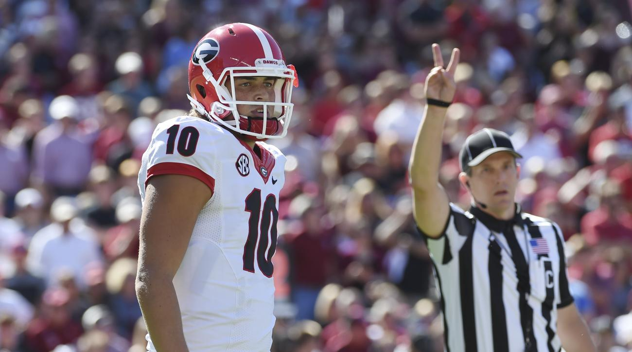 FILE - In this Sunday, Oct. 9, 2016,  file photo, Georgia quarterback Jacob Eason (10) waits for a play during the first half of an NCAA college football game against South Carolina  in Columbia, S.C. Eason looks very much like a freshman quarterback. He