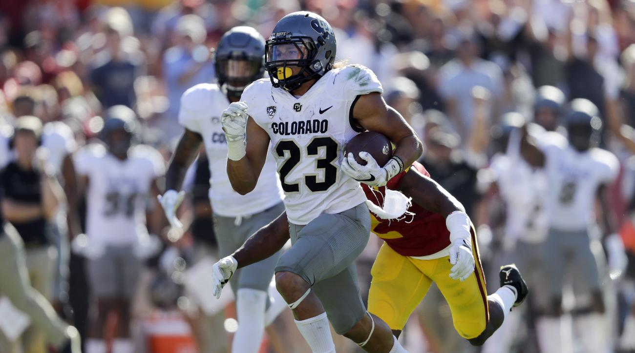 FILE - In this Saturday, Oct. 8, 2016, file photo, Colorado tailback Phillip Lindsay carries the ball during the second half of an NCAA college football game against Southern California in Los Angeles. His nickname: Tasmanian Devil. His hair: Everywhere.