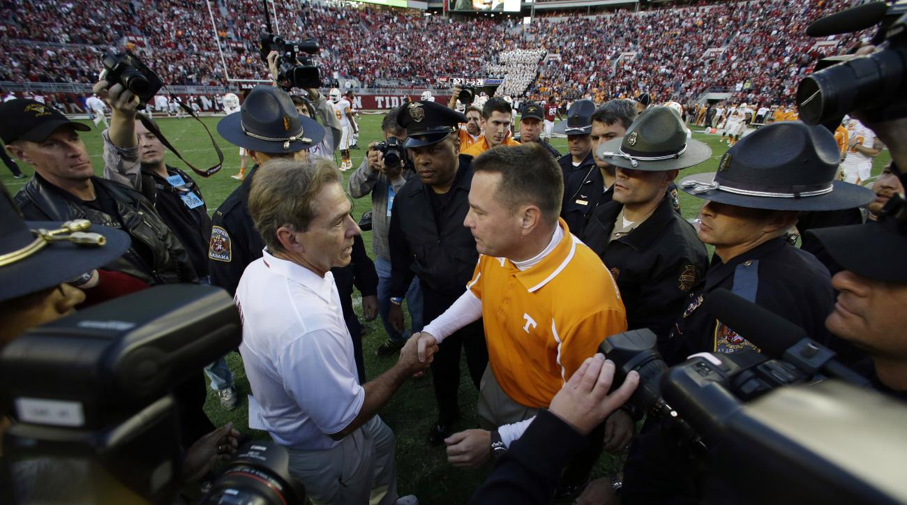 FILE - In this Oct. 26, 2013, file photo, Tennessee head coach Butch Jones, right, congratulates Alabama head coach Nick Saban after their NCAA college football game in Tuscaloosa, Ala. If No. 1 Alabama and No. 2 Ohio State are going to lose this season,