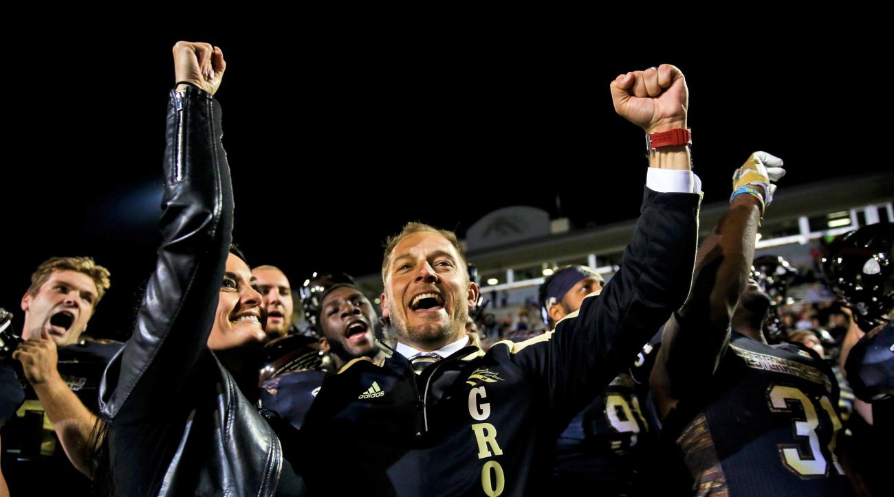 FILE - In this Saturday, Oct. 8, 2016, file photo, Western Michigan head coach P.J. Fleck celebrates with his team  after their 45-3 win over Northern Illinois in an NCAA college football game  in Kalamazoo, Mich. Western Michigan, off to its best start s