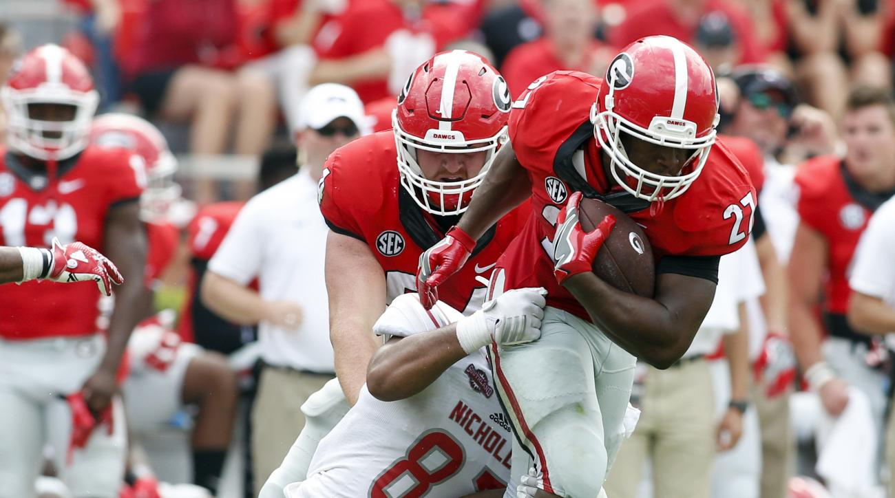 FILE - In this Sept. 10, 2016, file photo, Nicholls defensive lineman Terrell Encalade (87) tackles Georgia running back Nick Chubb (27) in the second half of an NCAA college football game in Athens, Ga. The Southeastern Conference, which already made his