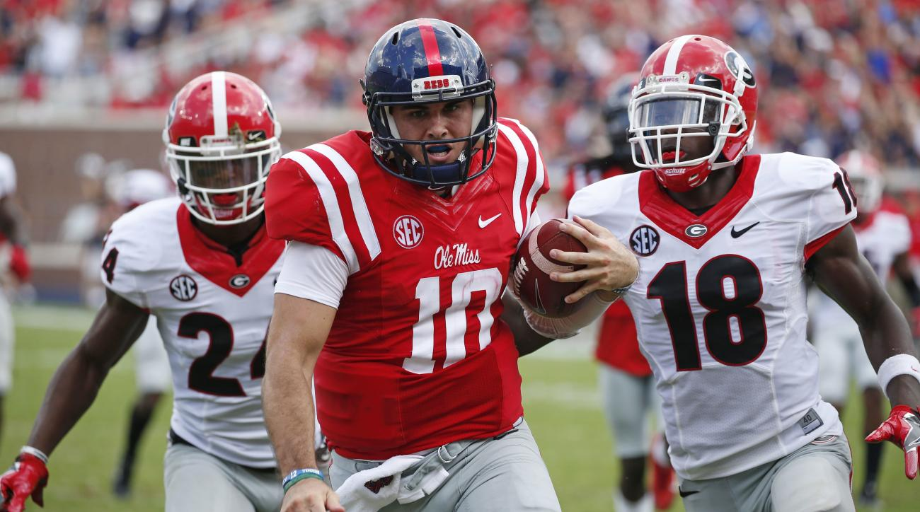 FILE - In this Sept. 24, 2016, file photo, Mississippi quarterback Chad Kelly (10) runs past Georgia cornerback Deandre Baker (18) and safety Dominick Sanders (24) for a 41-yard touchdown run during the second half of an NCAA college football game in Oxfo
