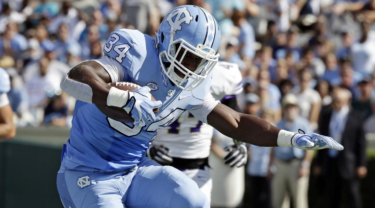FILE - In this Sept. 17, 2016, file photo, North Carolina's Elijah Hood (34) jumps over James Madison's Rashad Robinson (22) during the first half of an NCAA college football game in Chapel Hill, N.C. North Carolina coach Larry Fedora said Wednesday, Oct.