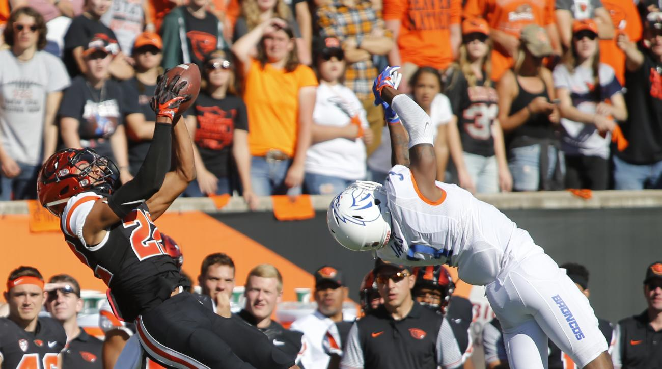 FILE - In this Sept. 24, 2016, file photo, Oregon State's Seth Collins, left, gets behind Boise State's Brandon Arnold, right, to make a catch in the second half of an NCAA college football game in Corvallis, Ore. The change in positions for Oregon State