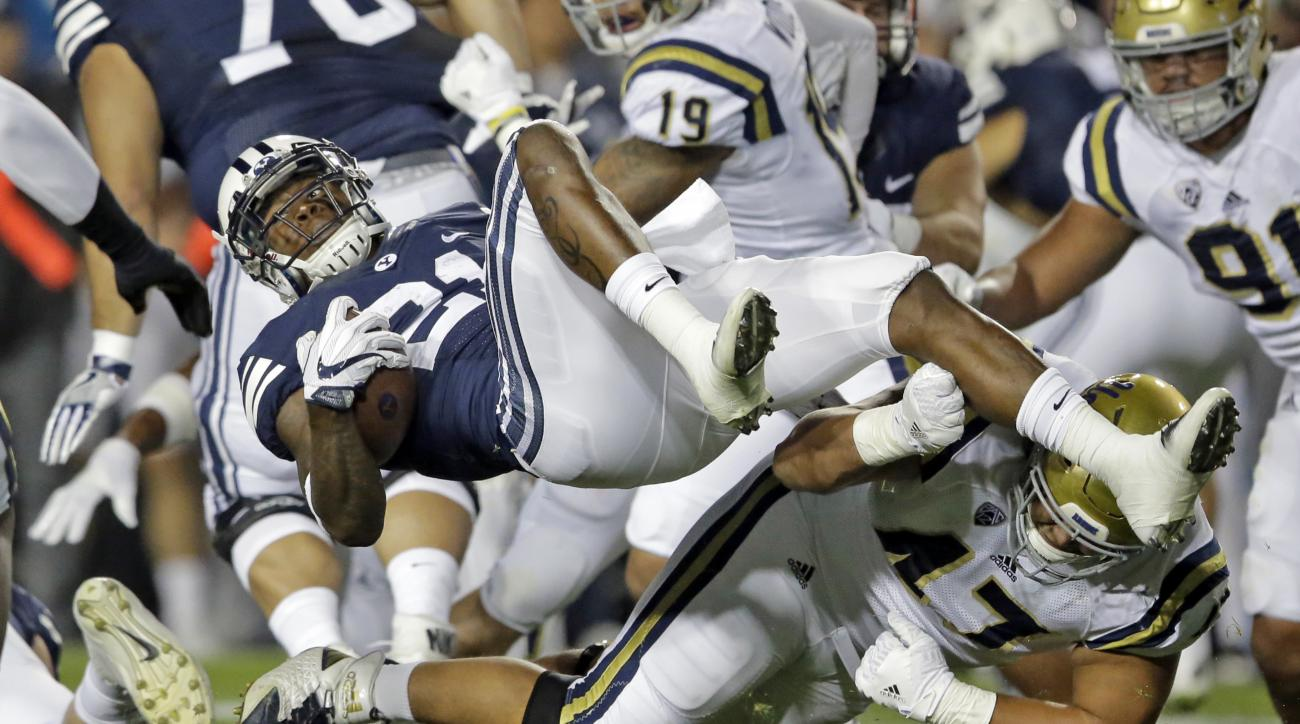 FILE - In this Sept. 17, 2016, file photo, UCLA defensive lineman Eddie Vanderdoes (47) tackles BYU running back Jamaal Williams (21) during the first half of an NCAA college football game, in Provo, Utah. The maturation of Williams has led to this moment