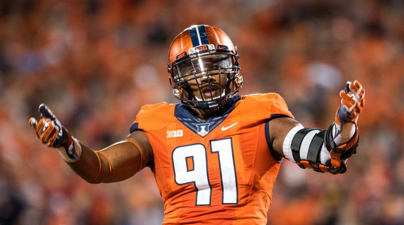 FILE - In this Sept. 10, 2016, file photo, Illinois defensive lineman Dawuane Smoot encourages the fans during an NCAA college football game against North Carolina in Champaign, Ill. Defense remains a cornerstone of Lovie Smith's plans for Illinois, parti