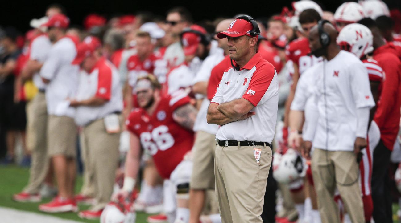 FILE - In this Oct. 1, 2016, file photo, Nebraska coach Mike Riley follows the first half of an NCAA college football game against Illinois in Lincoln, Neb. Coach Mike Riley always believed he could turn Nebraska into a Top 10 team. Five games into his se