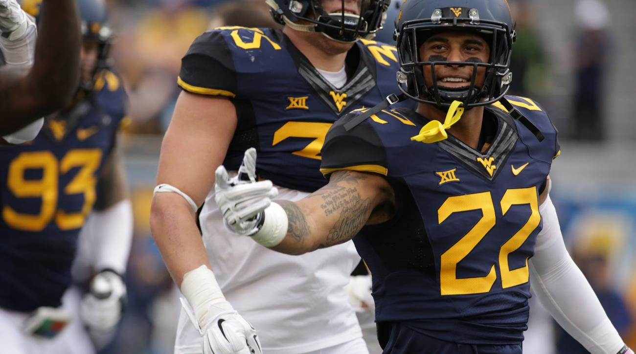 FILE - In this Nov. 28, 2015, file photo, West Virginia safety Jarrod Harper (22) gestures during an NCAA college football game in Morgantown, W.Va. West Virginia will find out whether a defense that began the season with eight new starters is ready for t