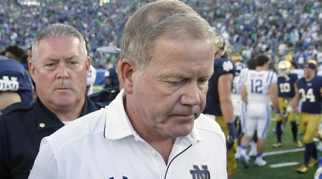 FILE - In this Sept. 24, 2016, file photo, Notre Dame head coach Brian Kelly walks off the field after an NCAA college football game against Duke, in South Bend, Ind. Duke defeated Notre Dame 38-35. When crunch time comes, the Irish offense is the one bei