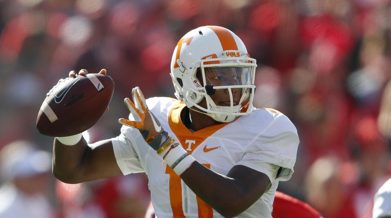 FILE - In this Oct. 1, 2016, file photo, Tennessee quarterback Joshua Dobbs throws from the pocket in the first half of an NCAA college football game against Georgia in Athens, Ga. Dobbs is fourth in the nation in total yards at 333.7 per game and he has