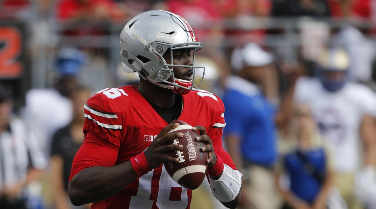 FILE - In this Sept. 10, 2016, file photo, Ohio State quarterback J.T. Barrett plays against Tulsa during the first half of an NCAA college football game in Columbus, Ohio. If he gets into trouble, Barrett can tuck the ball away and run. He had 137 yards