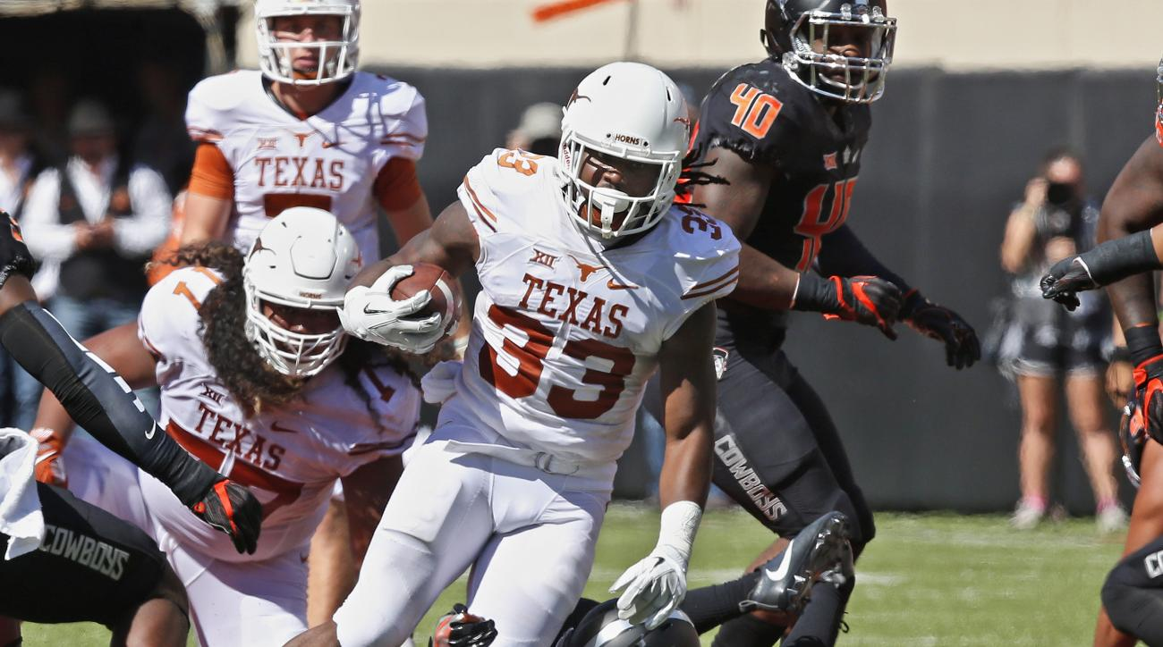 FILE - In this Oct. 1, 2016, file photo, Texas running back D'Onta Foreman (33) carries against Oklahoma State in the first half of an NCAA college football game, in Stillwater, Okla. While the Longhorns three-game losing skid keeps raising the pressure o