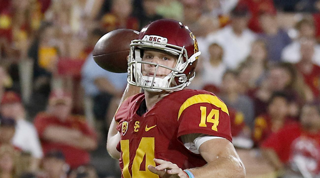 FILE - In this Oct. 1, 2016, file photo, Southern California quarterback Sam Darnold (14) throws a touchdown pass to wide receiver JuJu Smith-Schuster (9) during the first half of an NCAA college football game against Arizona State, in Los Angeles. USC ta