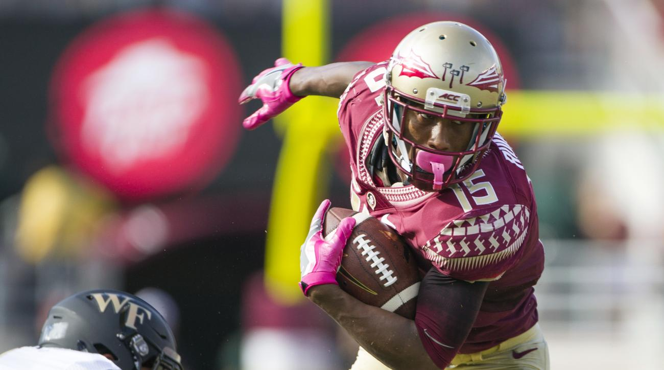 Florida State wide receiver Travis Rudolph (15) sheds Wake Forest defender Jesse Bates III in the first half of an NCAA college football game in Tallahassee, Fla., Saturday, Oct. 15, 2016. (AP Photo/Mark Wallheiser)