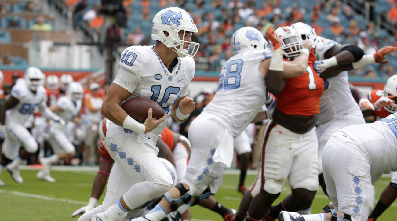 North Carolina quarterback Mitch Trubisky (10) runs with the football during the first half of an NCAA college football game against Miami, Saturday, Oct. 15, 2016, in Miami Gardens, Fla. (AP Photo/Lynne Sladky)