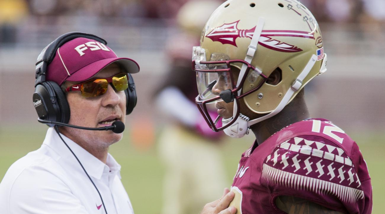 Florida State head coach Jimbo Fisher, left, stops his quarterback Deondre Francois to talk after Francois threw an interception in the second half of an NCAA college football game against Wake Forest in Tallahassee, Fla., Saturday, Oct. 15, 2016. (AP Pho