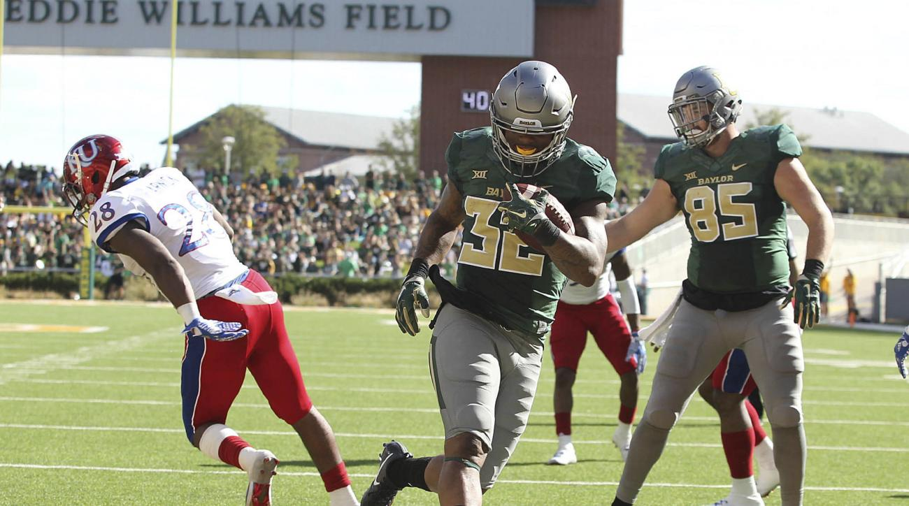 Baylor running back Shock Linwood (32) scores past Kansas linebacker Courtney Arnick, left, in the first half of their NCAA college football game, Saturday, Oct. 15, 2016, in Waco, Texas. Baylor won 49-7. (Jerry Larson/Waco Tribune Herald via AP)