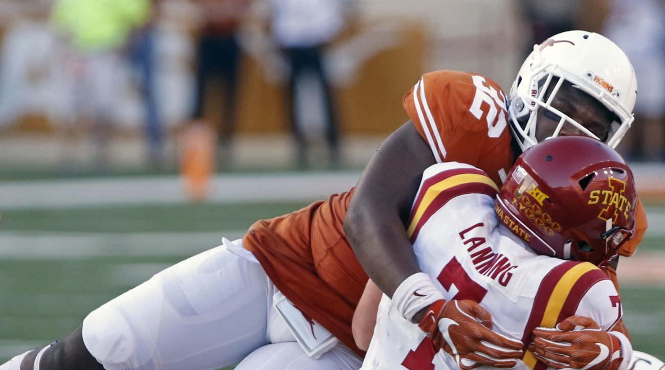 Iowa State quarterback Joel Lanning (7) is tackled by Texas' Malcolm Roach (32) and Jeffrey McCulloch (23) during the first half of an NCAA college football game, Saturday, Oct. 15, 2016, in Austin, Texas. (AP Photo/Michael Thomas)