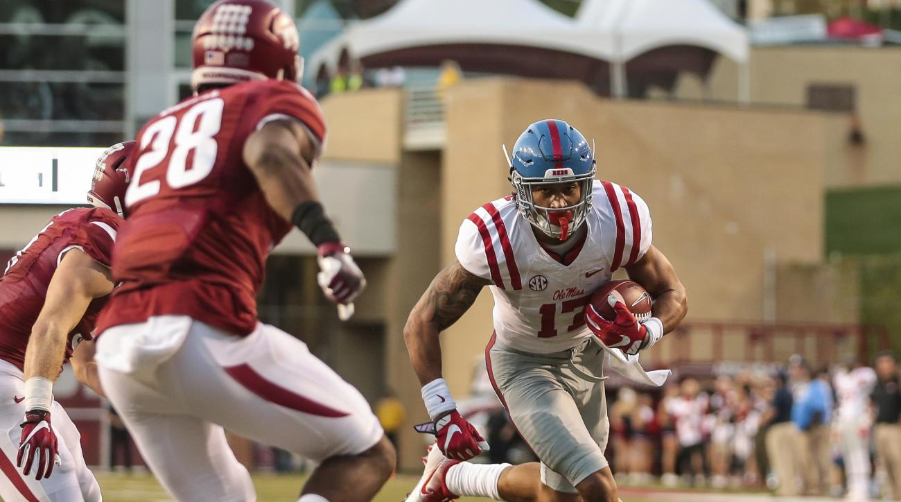 Mississippi's tight end Evan Engram (17) looks to get past Arkansas' defensive back Josh Liddell (28) during the first quarter of an NCAA football game Saturday, Oct. 15, 2016, in Fayetteville, Ark. (AP Photo/Chris Brashers)