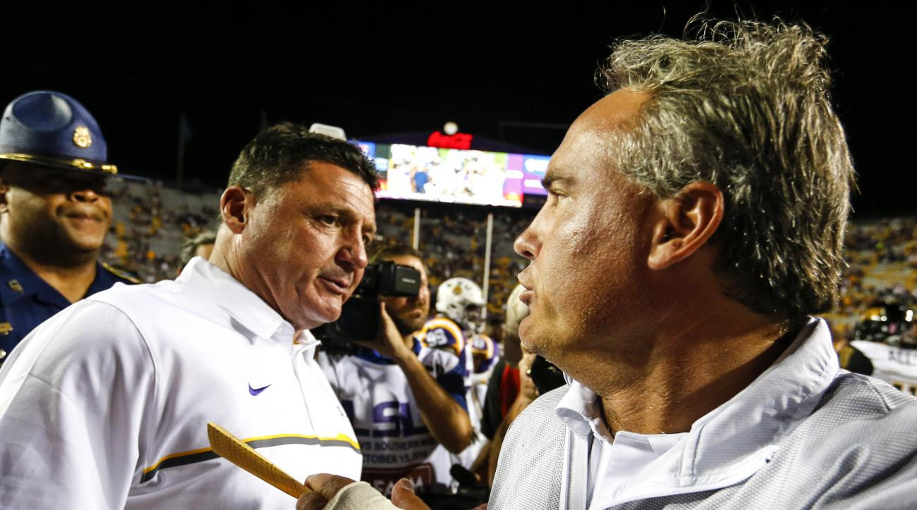LSU coach Ed Orgeron, left, shakes hands with Southern Mississippi coach Jay Hopson after an NCAA college football game, Saturday, Oct. 15, 2016, in Baton Rouge, La. LSU won 45-10. (AP Photo/Butch Dill)