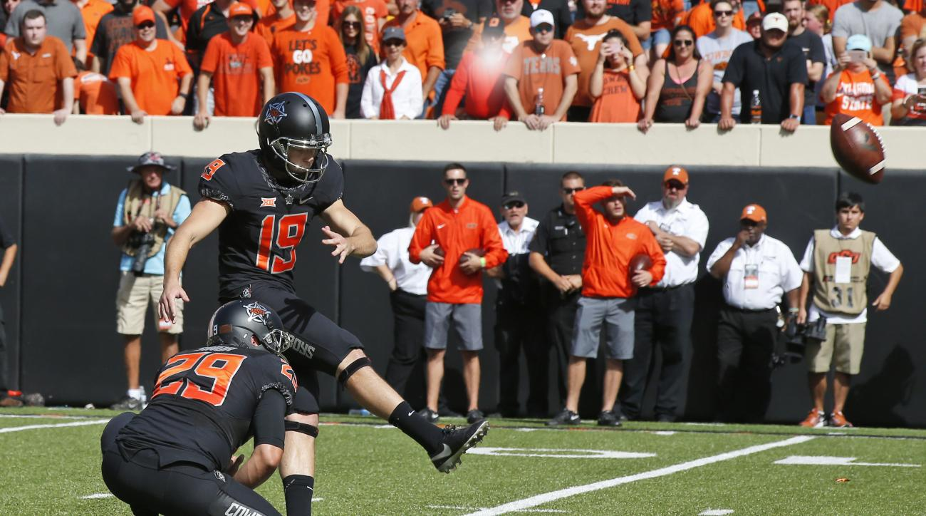 FILE - In this Saturday, Oct. 1, 2016 file photo, Oklahoma State place kicker Ben Grogan (19) kicks during an NCAA college football game between Texas and Oklahoma State in Stillwater, Okla. Grogan is about to become the Cowboys' all-time leading scorer.