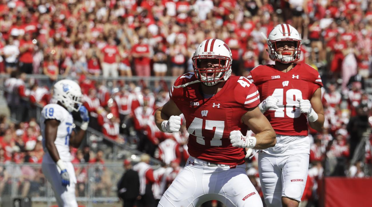 FILE - In this Sept. 17, 2016, file photo,k Wisconsin's Vince Biegel (47) celebrates after breaking up a third down play during the first half of an NCAA college football game against Georgia State, in Madison, Wis. Wisconsins defense could soon be gettin