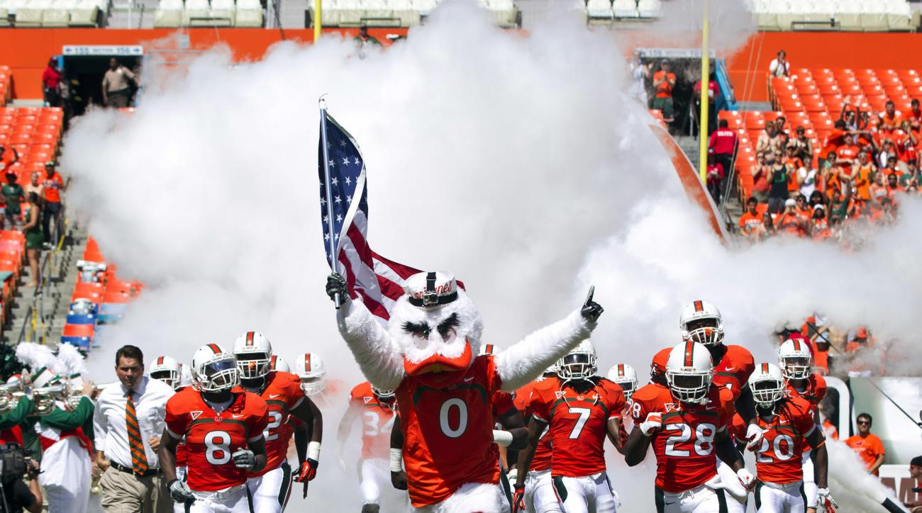 FILE - In this Sept. 29, 2012, file photo, University of Miami's mascot Sebastian the Ibis leads players onto the field before a NCAA college football game against North Carolina State in Miami. Miami's three-year NCAA probation largely stemming from the