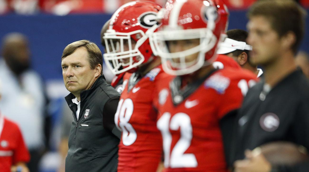 FILE - In this Sept. 3, 2016, file photo, Georgia head coach Kirby Smart looks on as his team warms up before an NCAA college football game against North Carolina, in Atlanta. The Bulldogs have the week off to try and figure how they can end a two-year sk