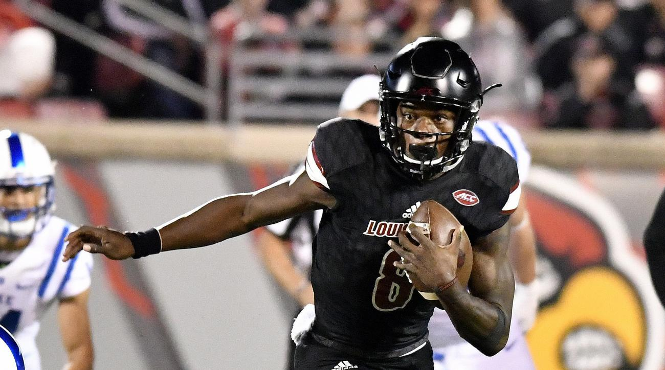 FILE - In this Oct. 14, 2016, file photo, Louisville quarterback Lamar Jackson (8) runs against Duke during the second half of an NCAA college football game, in Louisville, Ky. Jackson had an off night throwing the ball against Duke (13 for 26 for 181 yar