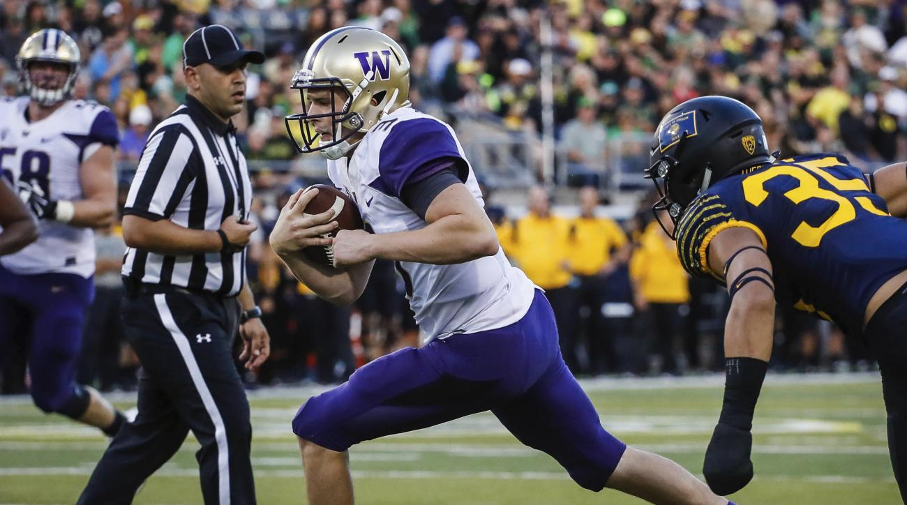 FILE - In this Oct. 8, 2016, file photo, Washington quarterback Jake Browning (3) scores on the last drive of the first half against Oregon in an NCAA college football game, in Eugene, Ore. The Heisman hopeful faces Oregon State this week. (AP Photo/Thoma