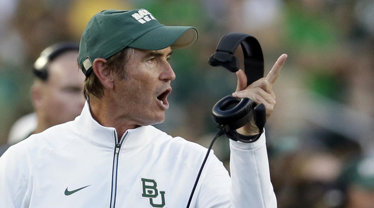 FILE - In this Sept. 12, 2015, file photo, Baylor coach Art Briles yells from the sideline during the first half of an NCAA college football game against Lamar in Waco, Texas. Baylor University's board of regents says it will fire Briles and re-assign uni