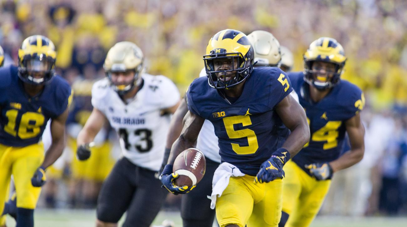 FILE - In this Sept. 17, 2016, file photo, Michigan linebacker Jabrill Peppers (5) returns a punt for a touchdown in the team's NCAA college football game against Colorado at Michigan Stadium in Ann Arbor, Mich. Peppers is listed on the roster as a lineba