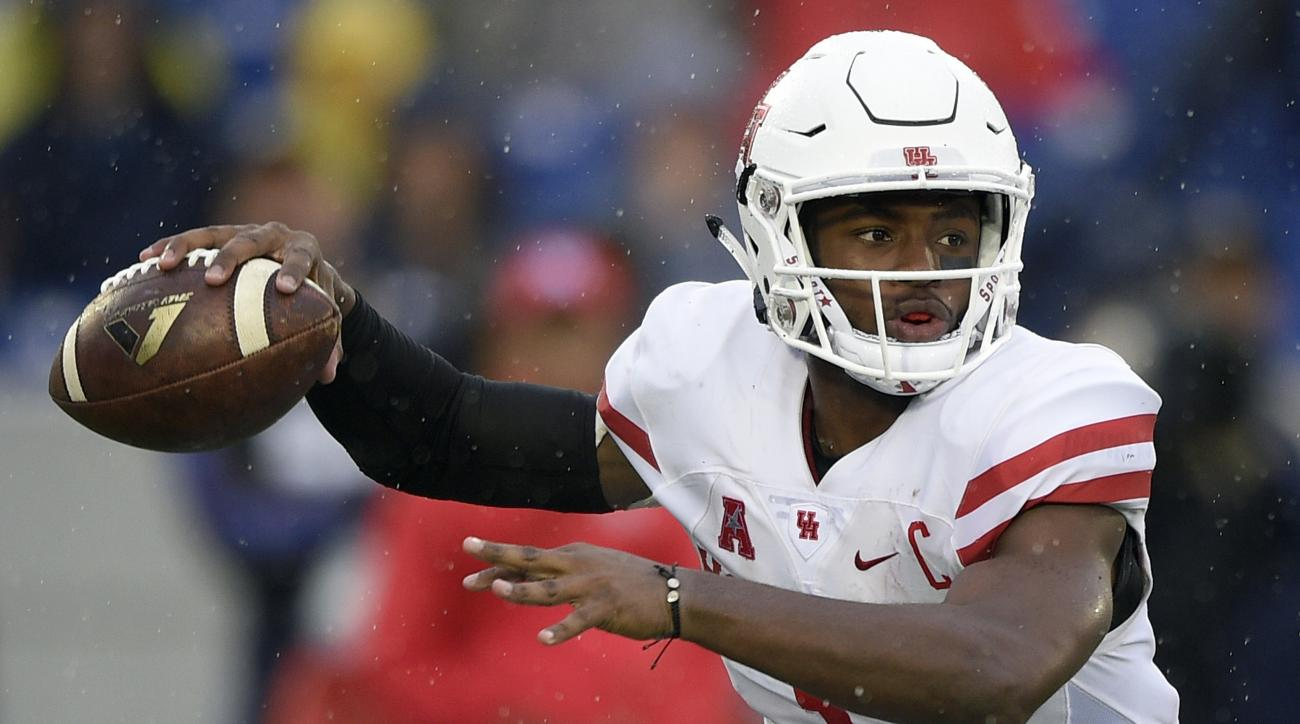 FILE - In this Oct. 8, 2016, file photo, Houston quarterback Greg Ward Jr. (1) looks to pass during the first half of an NCAA football game against Navy in Annapolis, Md. If Ward and the Cougars want to rekindle playoff hopes, they will need some convinci