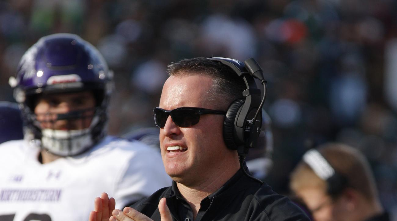 FILE - In this Oct. 15, 2016, file photo, Northwestern coach Pat Fitzgerald reacts during a timeout in the second quarter of an NCAA college football game against Michigan State, in East Lansing, Mich. The Wildcats head into Saturdays game against Indiana
