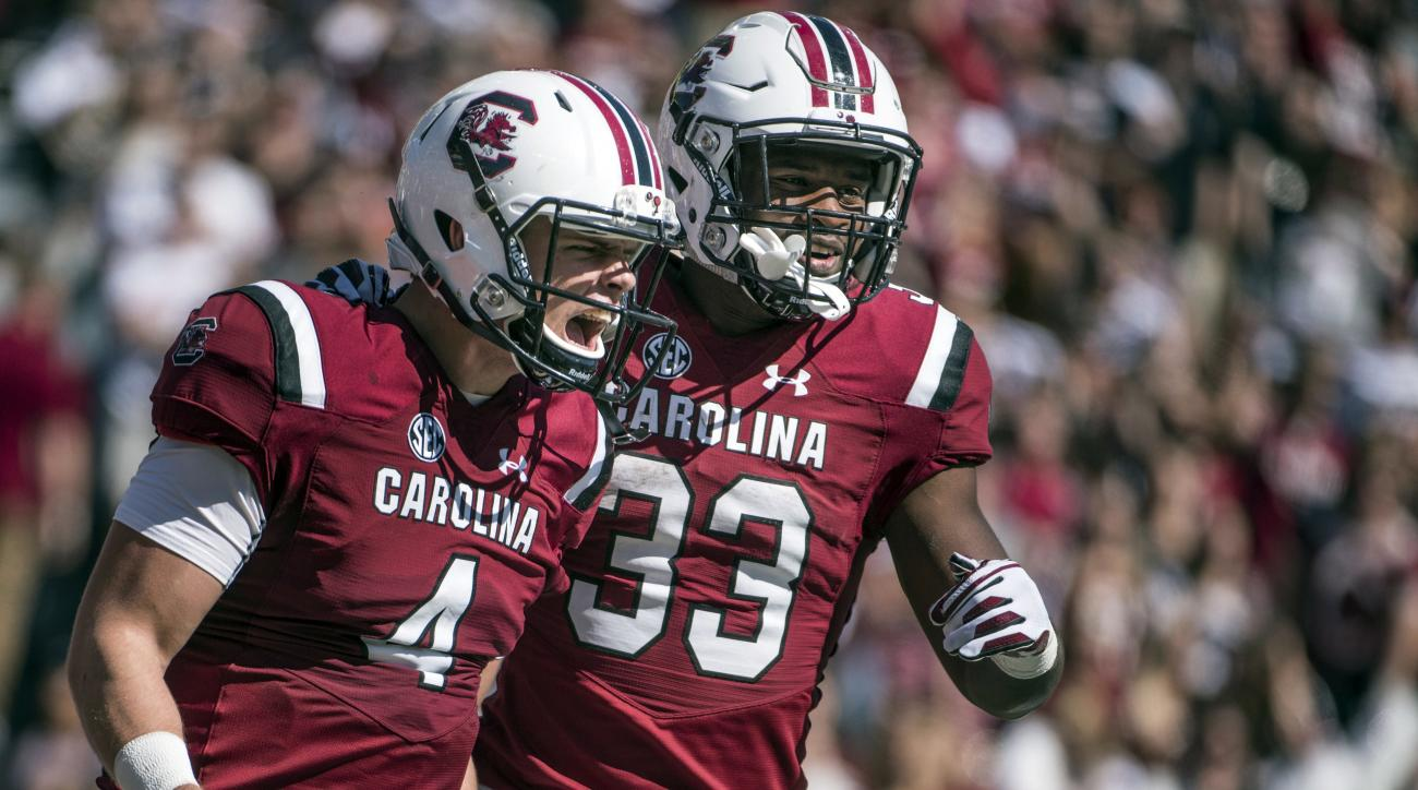 South Carolina starting quarterback Jake Bentley (4) and South Carolina running back David Williams (33) celebrate a touchdown during the first half of an NCAA college football game Saturday, Oct. 22, 2016, in Columbia, S.C. (AP Photo/Sean Rayford)