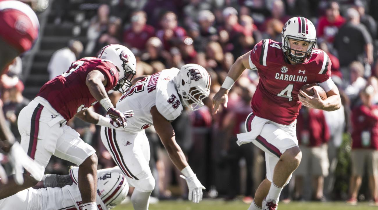 South Carolina quarterback Jake Bentley (4) runs the ball against Massachusetts linebacker Colbert Calhoun (35) during the first half of an NCAA college football game Saturday, Oct. 22, 2016, in Columbia, S.C. South Carolina defeated Massachusetts 34-28.