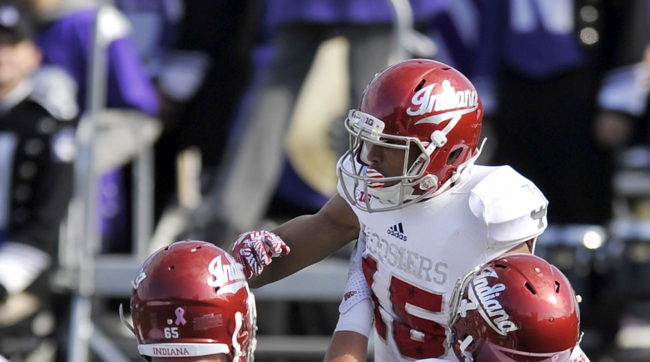 Indiana wide receiver Nick Westbrook (15) celebrates with teammates after rushing for a touchdown during the third quarter of an NCAA college football game against Northwestern Saturday, Oct. 22, 2016, in Evanston, Ill. Northwestern won 24-14. (AP Photo/P