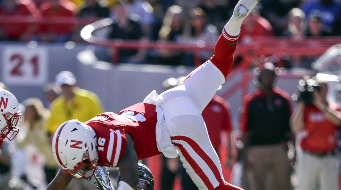 Purdue running back Markell Jones, back center left, makes a catch against Nebraska safety Antonio Reed (16), and linebacker Dedrick Young II (5) during the first half of an NCAA college football game in Lincoln, Neb., Saturday, Oct. 22, 2016. (AP Photo/N