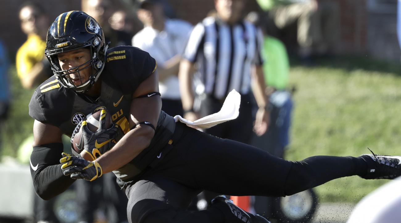 Missouri tight end Kendall Blanton dives into the end zone for a touchdown during the first half of an NCAA college football game against Middle Tennessee, Saturday, Oct. 22, 2016, in Columbia, Mo. (AP Photo/Jeff Roberson)