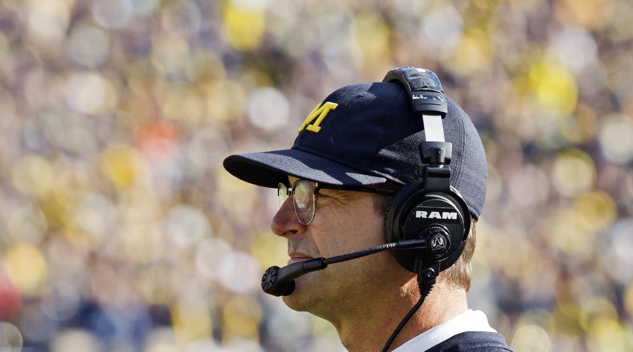 Michigan head coach Jim Harbaugh wears a headset and glasses on the sideline in the first quarter of an NCAA college football game against Illinois at Michigan Stadium in Ann Arbor, Mich., Saturday, Oct. 22, 2016. (AP Photo/Tony Ding)